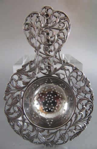 ‹ (•¿•) › 1916 : A Lovely Dutch Silver Tea Strainer With Leaves & Birds photo