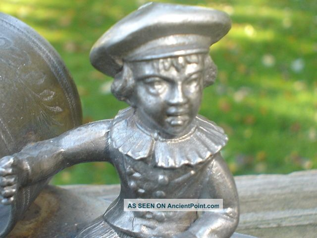 Figural Silverplate Or Pewter Napkin Ring Holder Boy On Bench Vintage Napkin Rings & Clips photo