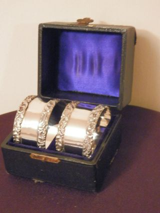 Pair Of Silver Napkin Rings With Raised Design.  Marked Birmingham 1907 Perfect photo