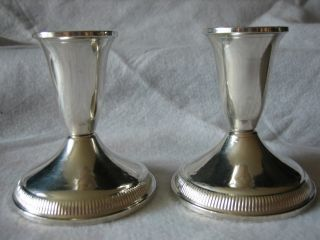Pair Of Raimond Sterling Silver Weighted Candlesticks photo