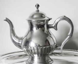 An Attractive Vintage Silver Plated Coffee Pot. photo