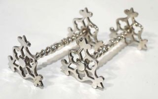 Pair Of Antique Silver Plated Knife Rests. photo