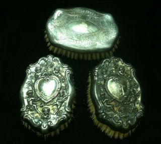 3 Antique Victorian Silver Topped Vanity Brushes Cherubs photo
