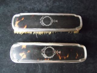 A Pair Antique Solid Silver And Faux Shell Clothes Brushes photo