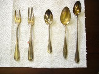 A Bunch Of Different Silver Plated Spoons,  Knife ' S And Fork ' S photo