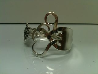Silver Plated Fork Bracelet - Intertwining Hearts photo