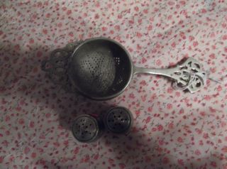 Sterling Silver 1920s Tea Strainer And Salt And Pepper Set. photo