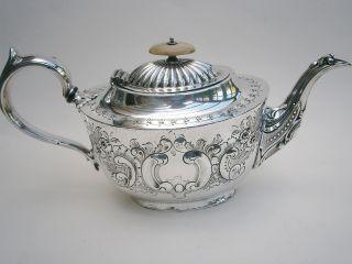 Late Victorian Ornate Silver Plated Tea Pot photo