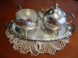 Footed Silver On Copper Covered Sugar Bowl & Creamer With Tray photo
