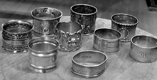 Napkin Ring Sterling Collection.  9pc.  7 Signed,  2 Hand Tooled.  7.  30 Oz Total Weight photo