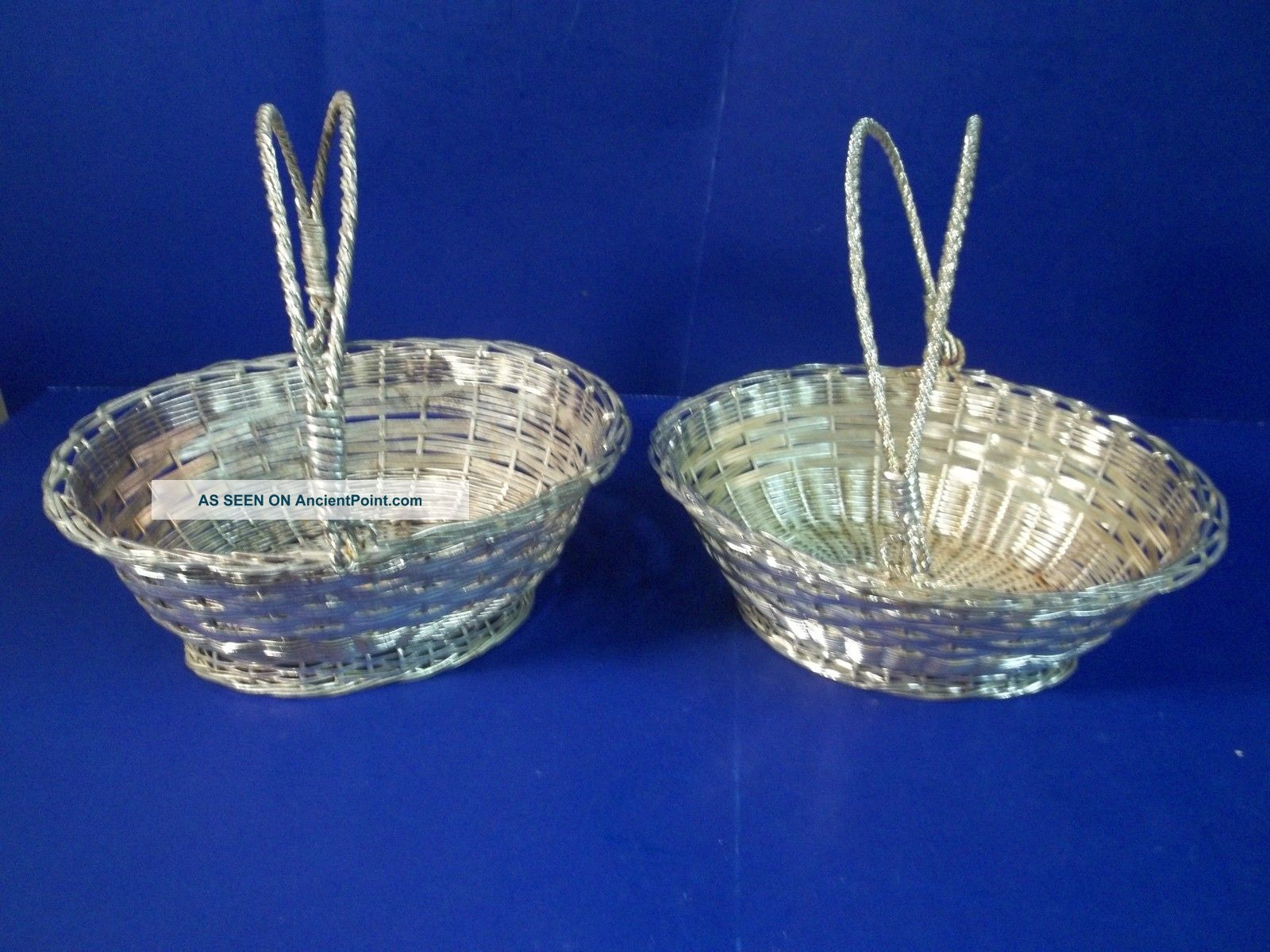 Pair Of Silverplated Wire Baskets Baskets photo
