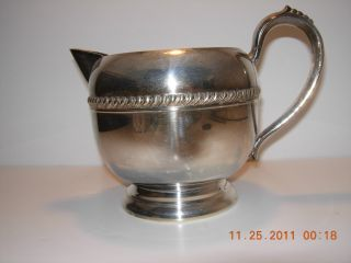 Silver On Copper Water Pitcher photo