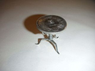Chinese Silver Miniature Table Made From One Yen Coin And Sitting On 3 Leg Base photo