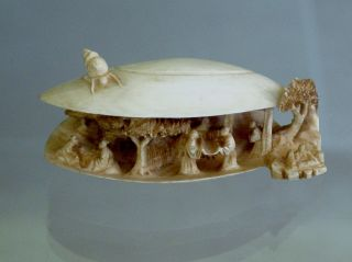 Ox Bone Chinese Shell,  With Carved Chinese Village Inside With Trees And People. photo