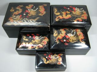 5 Vintage Chinese Black Laquered Stacking Dragon Boxes photo