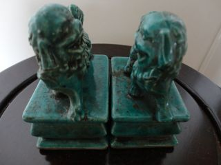 Pair Of Old Chinese Porcelain Dog Statues With Blue/green Glaze photo