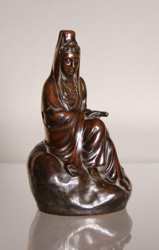 A Chinese Bronze Figure Of Guanyin photo