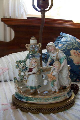 German Made Lamp With Figurines.  Wonderful photo