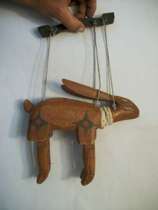 Vintage Primitive Folk Art Carved Wood Jointed Rabbit Puppet. photo