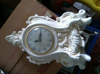 Old Porcelain Clock With Cupids. photo