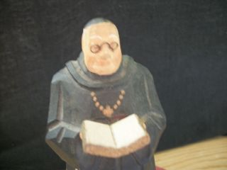 A Priest With Bible Or Some Religious Word.  View For Own Decision Making. photo