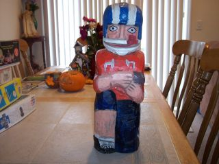 Vintage Wooden Hand Carved Wooden Football Player Bottle Holder photo