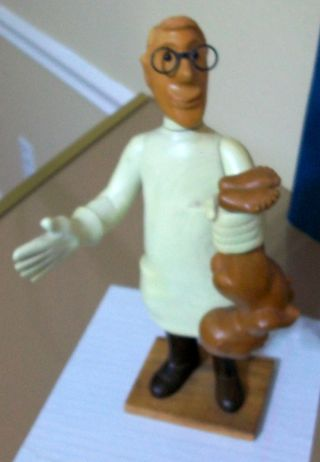 Carved Wooden Obstetrician Doctor With Baby Made In Italy photo
