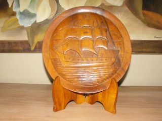 Carved Ship On Wooden Plate With Stand. photo