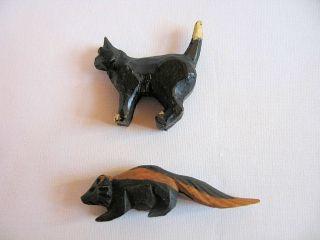 Vintage American Folk Art Miniature Wood Animal Carvings Black Cat & Skunk photo