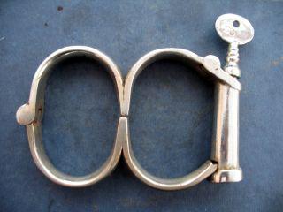 Handcuffs 1890 - 1910 Made By Hiatt. photo