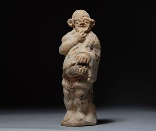 Ancient Greek Terracotta Statuette Figure Of An Actor photo
