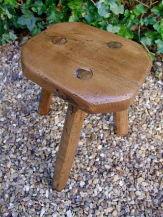 An Antique Rustic Elm Milking Stool photo