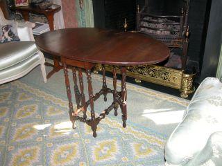 American Cherry Wood Oval Gateleg Table photo