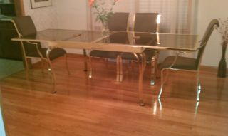 Expandable Brass Dining Room Set photo