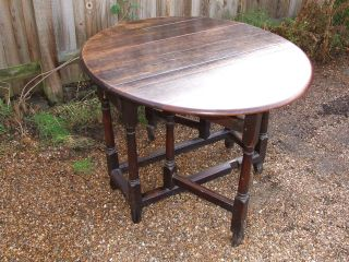 Charles I Oak Double Gate Leg Table.  C1649 With Fluted Bracket Feet.  Seats Four. photo