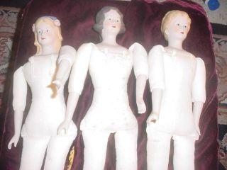 Xmas Three Antique Shoulder And Limb Dolls photo