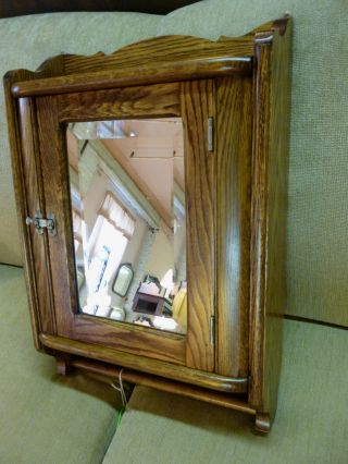Antique Oak Medicine Cabinet (refinished) Marked Philadelphia Pa.  Beveled Mirror photo