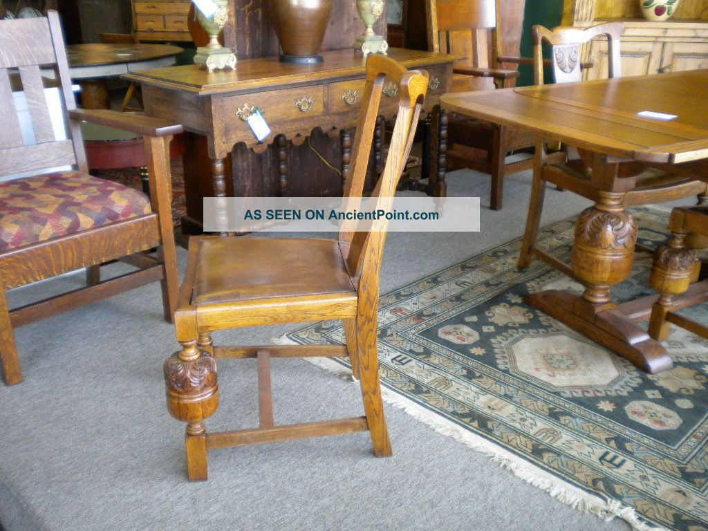 english oak carved pub table with matching chairs