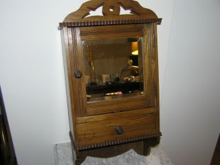 Antique Hanging Cabinet With Cut Glass Mirror. photo
