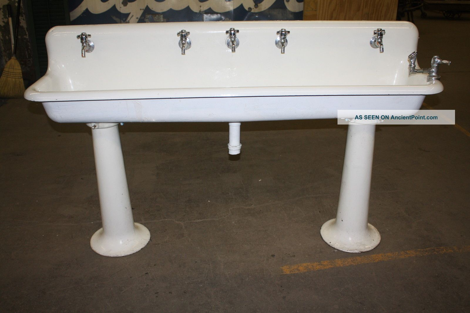 old school industrial porcelain gang sinks on pedestal legs for the ...