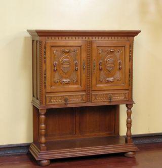 928 : Oak Carved Spanish Style Cabinet photo