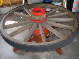 Antique Wagon Wheel Coffe Table And Light Fixtures photo