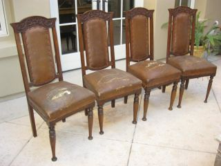 Set Of Four Antique Spanish Style Leather Carved Chairs Dining Chairs photo