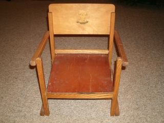 Vintage Wooden Potty Chair With Lion Decal photo