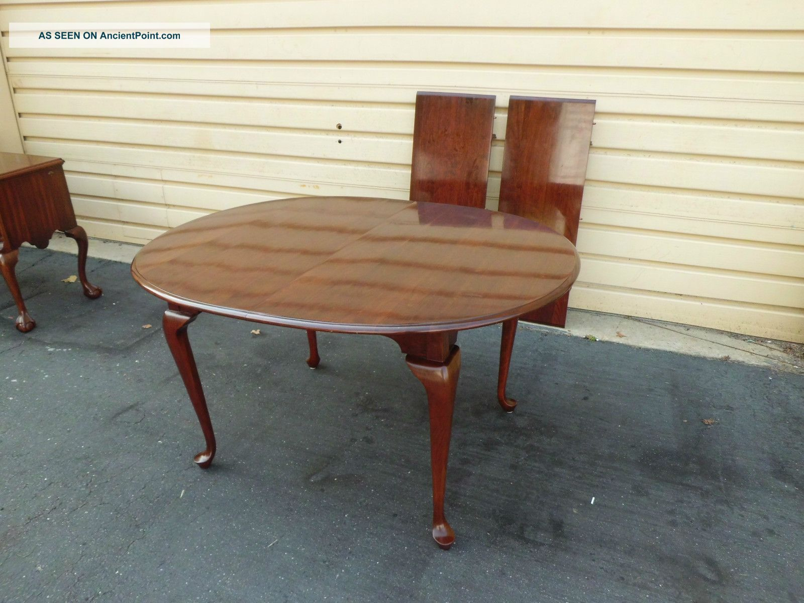 http://ancientpoint.com/imgs/a/e/j/d/g/50784_solid_cherry_pennsylvania_house_dining_room_table_with_2_leafs_1_lgw.jpg