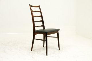 4 Rosewood Chairs By Niels Kofoed photo