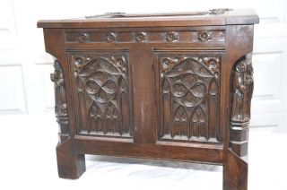 French Gothic Trunk In Oak Carved Statues photo