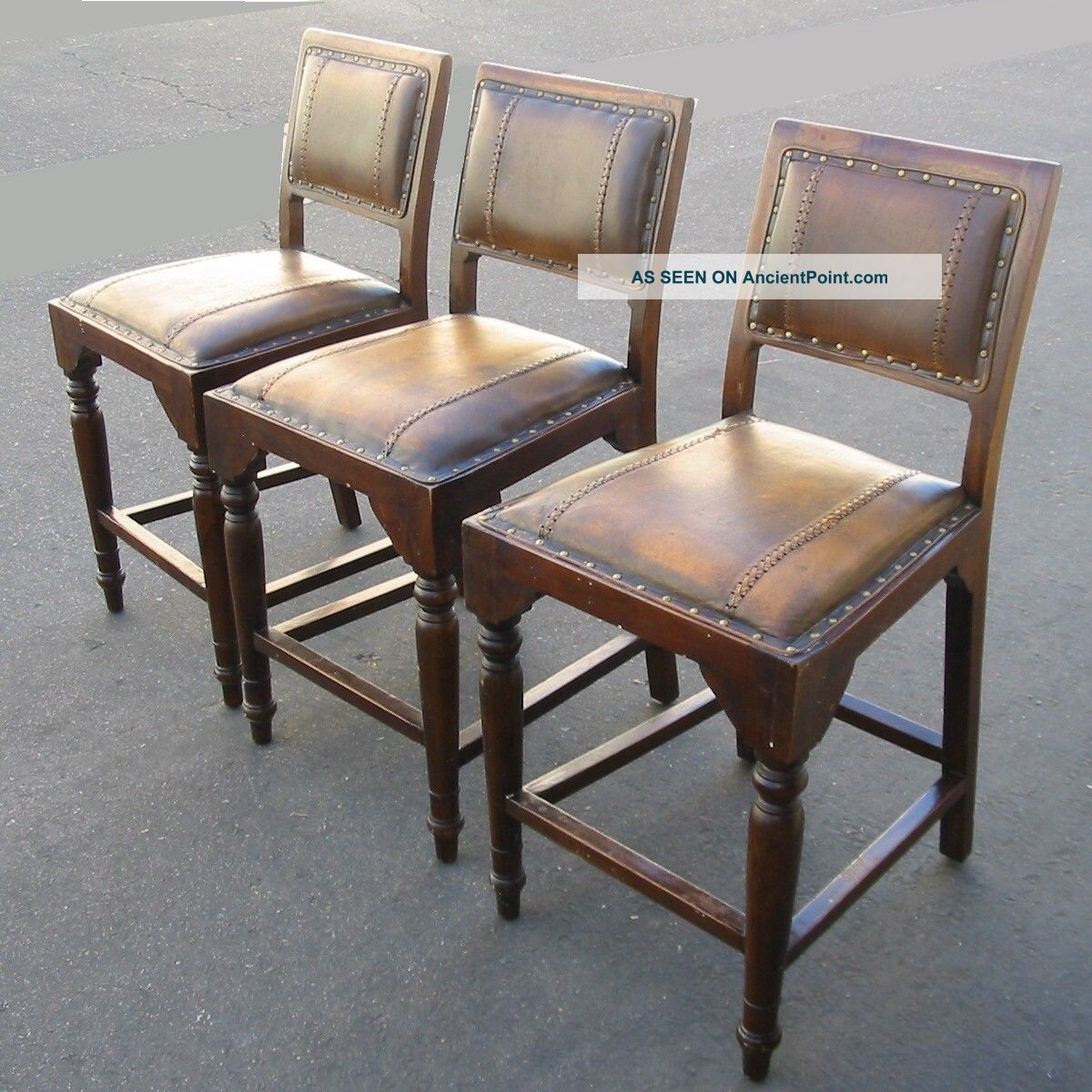 three brown leather spanish style bar stools bench stools