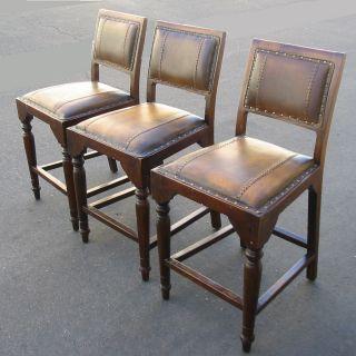 Three Brown Leather Spanish Style Bar Stools Bench Stools photo