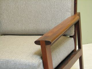 Mid Century Danish Modern Lounge Chair.  Rosewood Frame Gray Cushion.  Minimalist photo